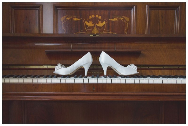 Bridal shoes on piano