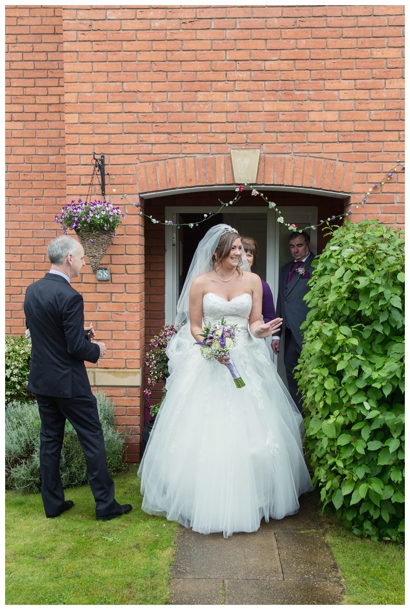 Bride leaving house for wedding
