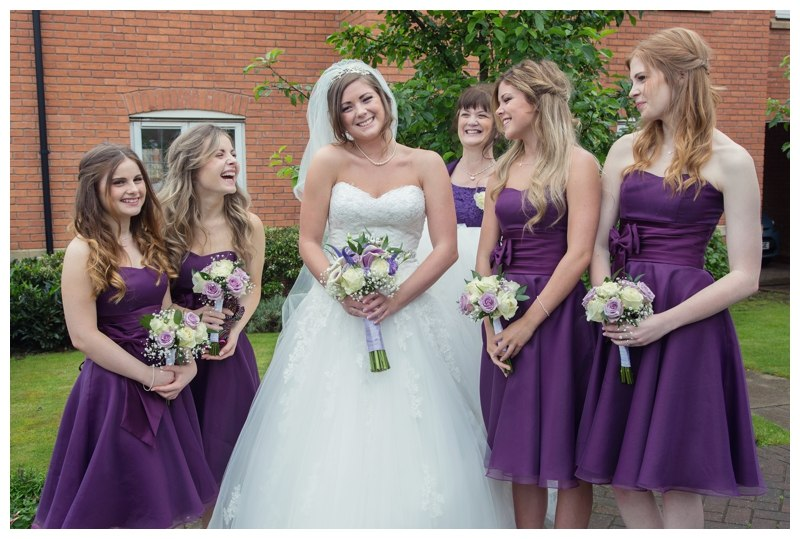 Bride with Bridesmaids outside the house
