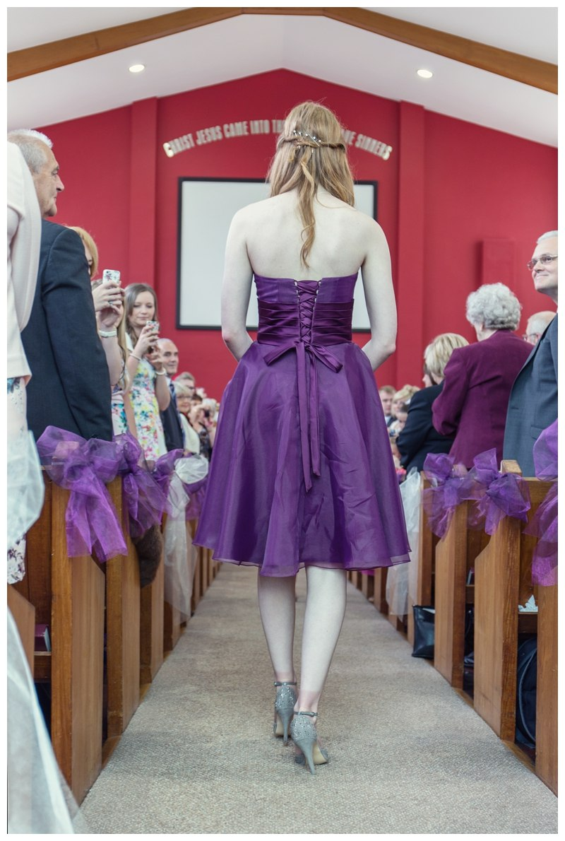 Bridesmaid walking down the isle