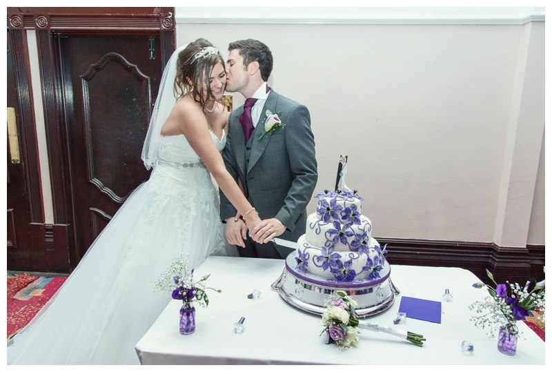 Bride and groom cut the cake at the royal courth hotel Coventry