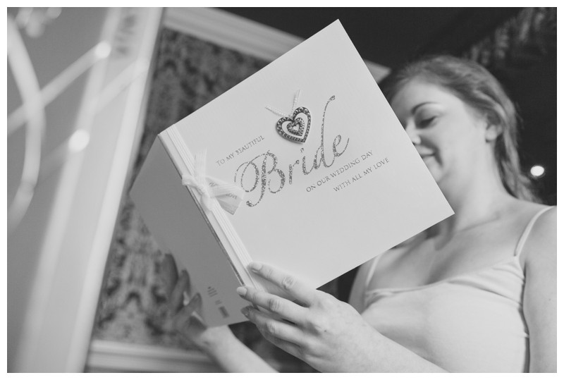 Bride opens card from Husband