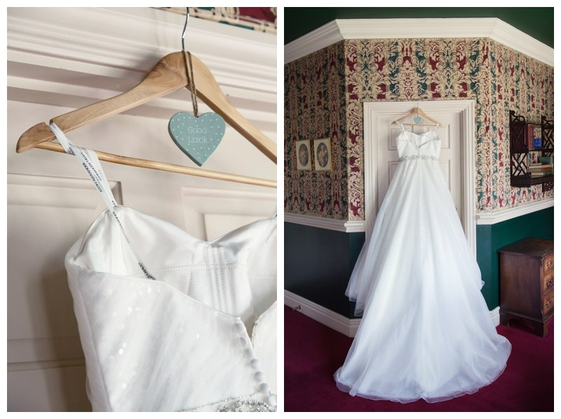 Bridal gown hanging on the door