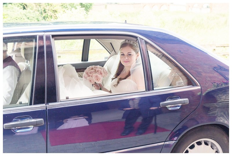 Bride pulling up in car