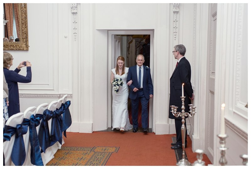 Bride entering the room with her dad