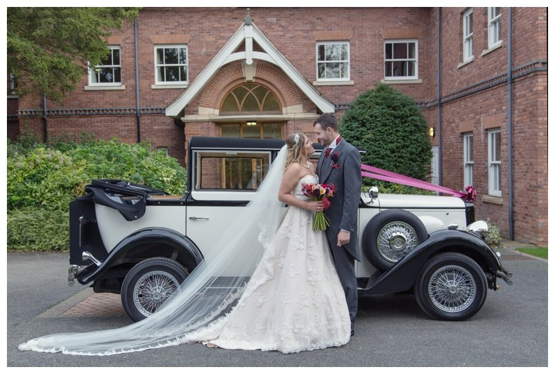 Bride and Groom next to the wedding car