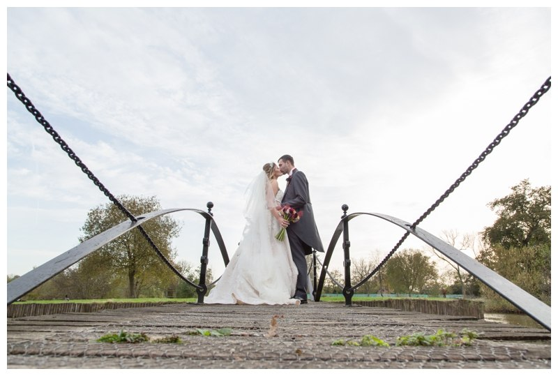 Bride and Groom on Bridge at Ardencote Manor