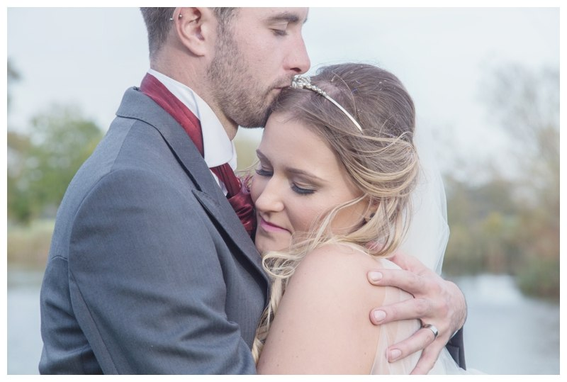 Bride and Groom by the lake Ardencote Manor