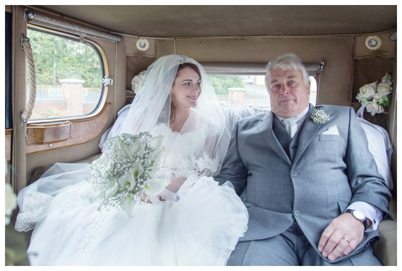 bride in the car with her dad