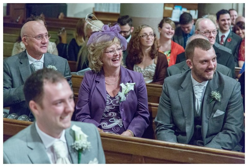 guests laughing at vicar