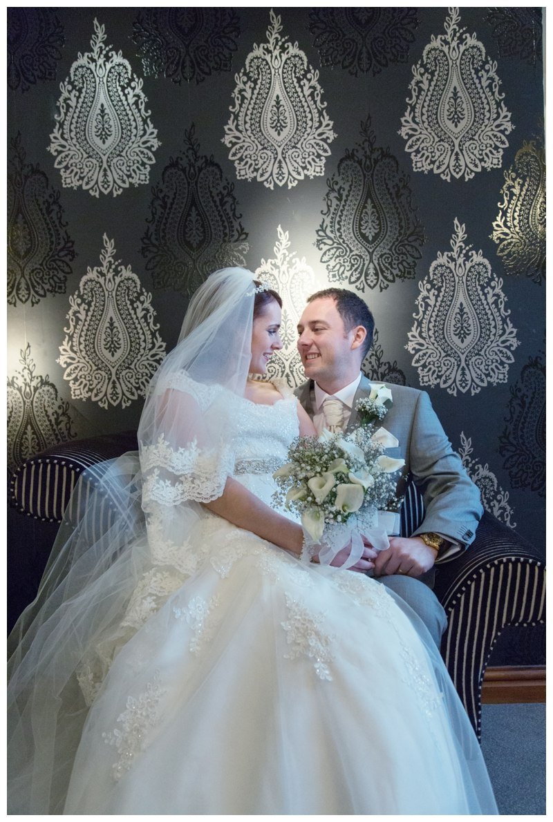 bride and groom on chair