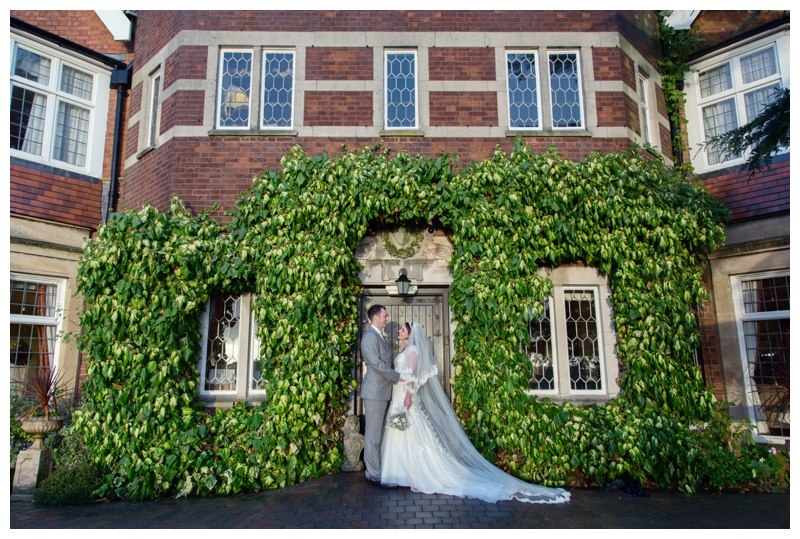 bride and groom at nuthurst grange entrance