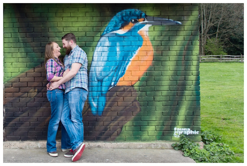 Couple by a mural in Sutton Park