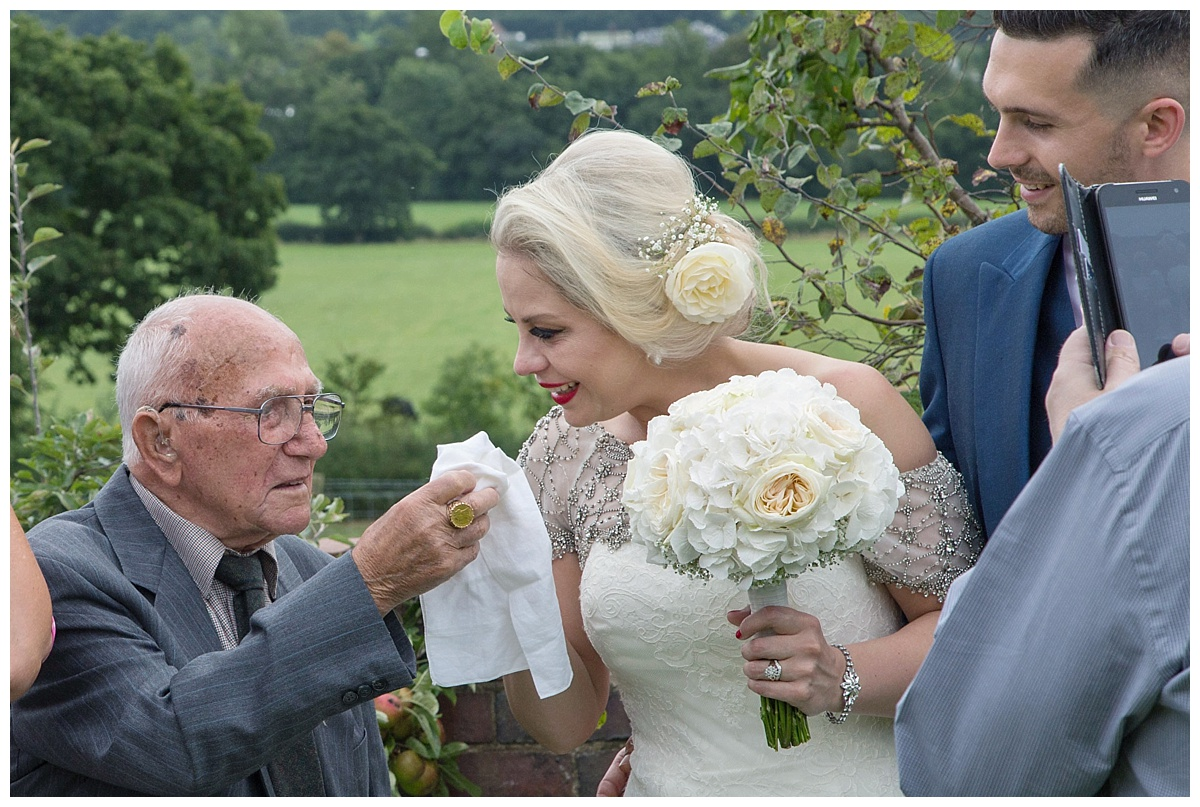 Grandad gives bride a tissue