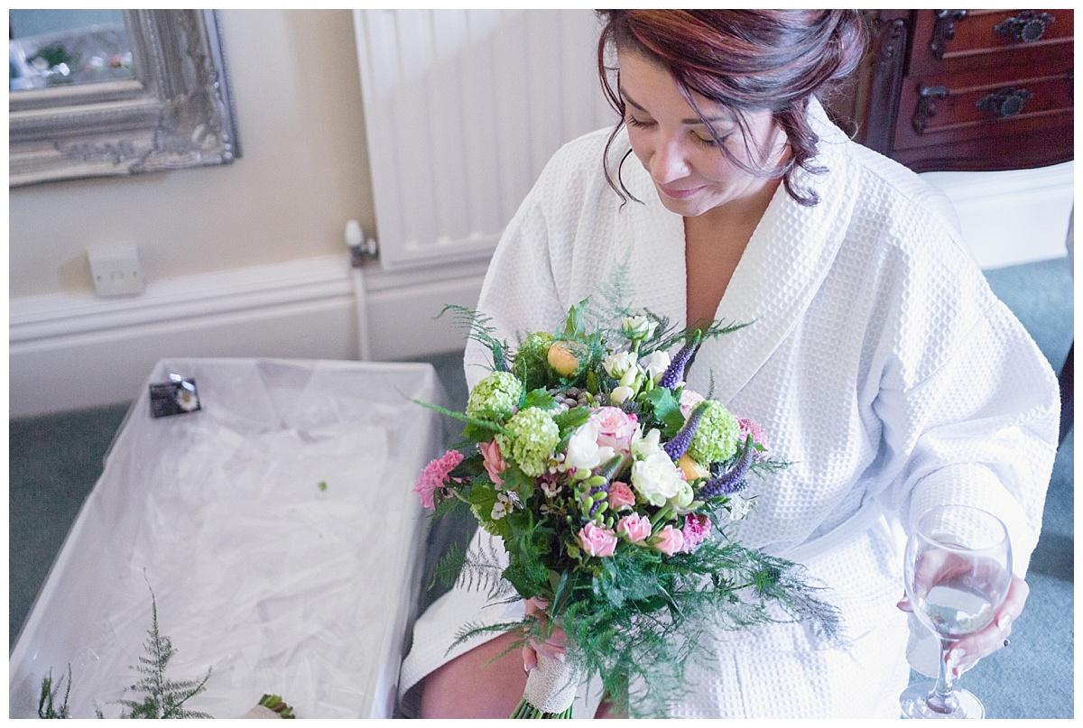 bride receiving flowers