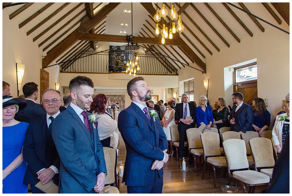 groom in ceremony room