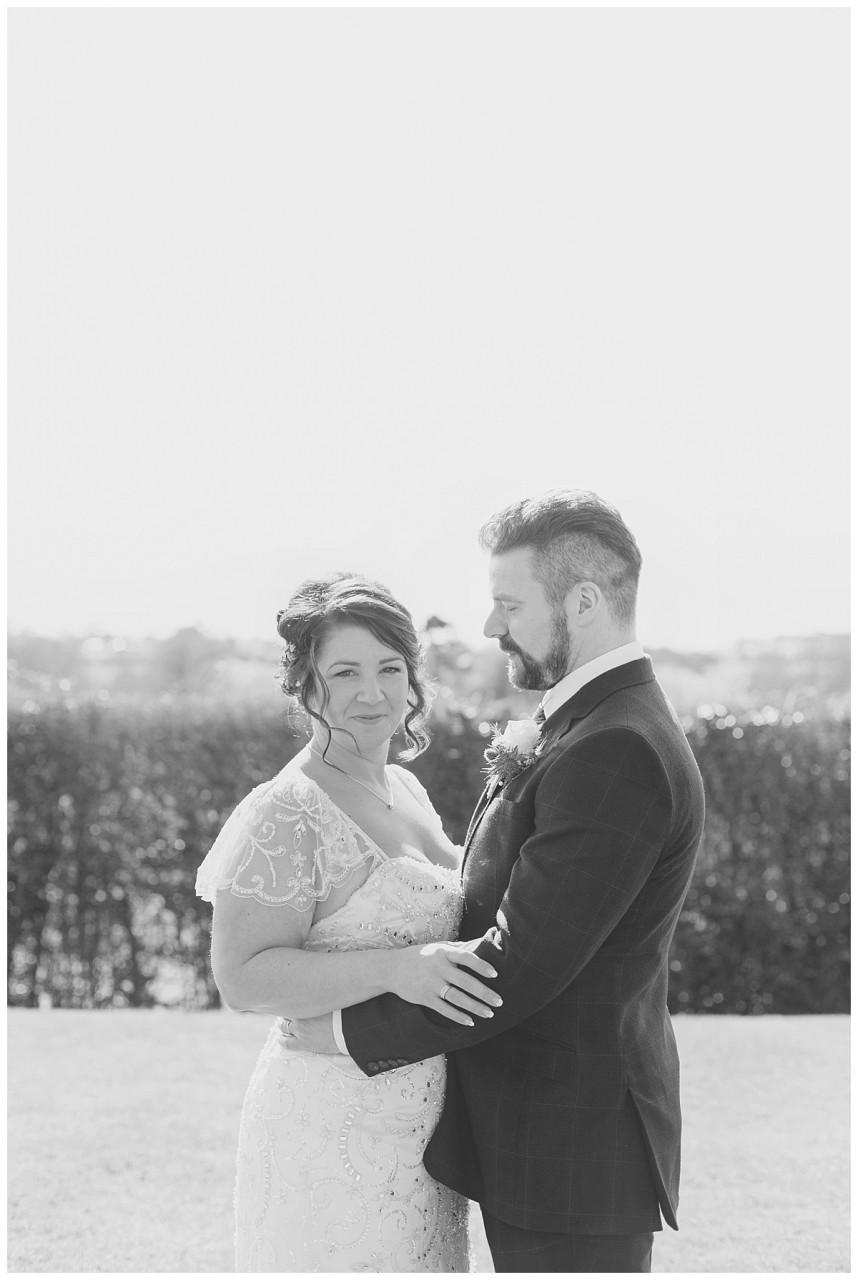 bride and groom on the helipad