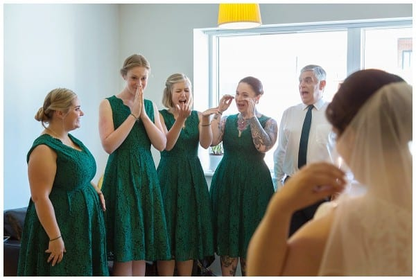 Dad and bridesmaid reaction
