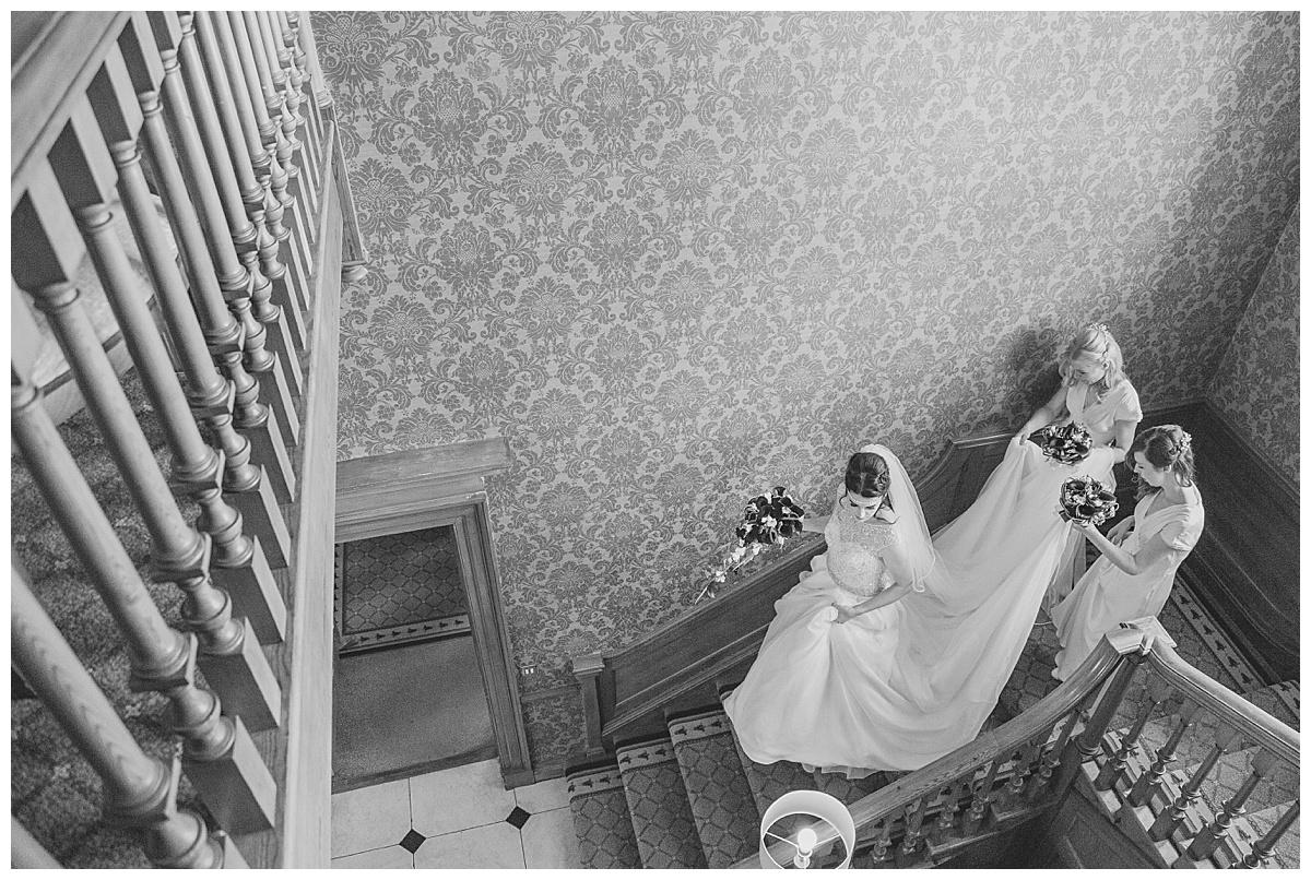 Bride coming down stairs Brockencote hall