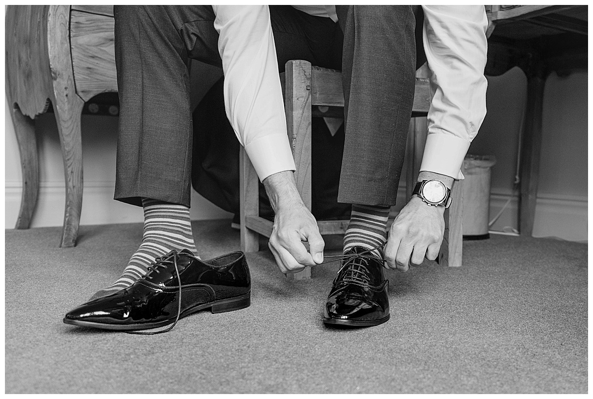 Groom putting on shoes Coombe Abbey