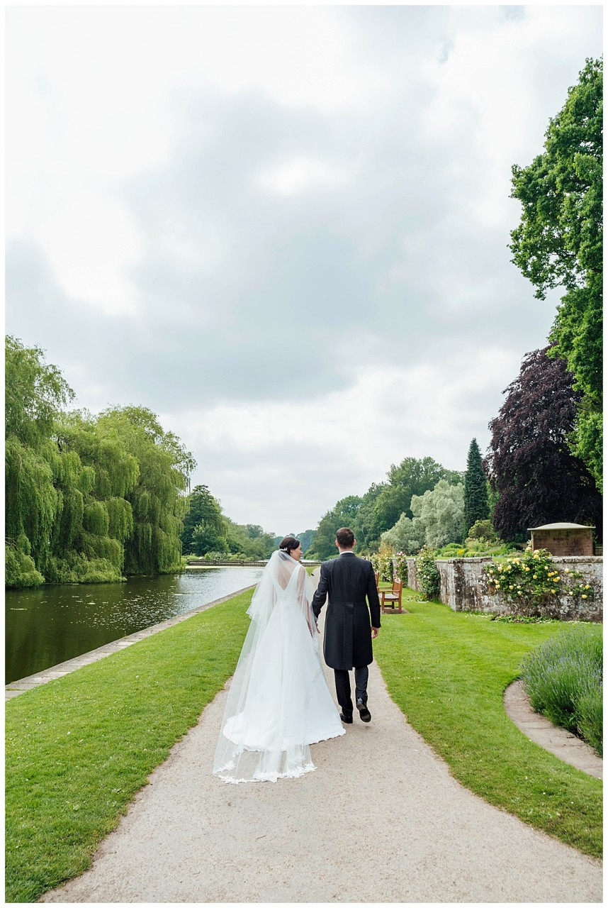 Bride and groom walking Coombe Abbey