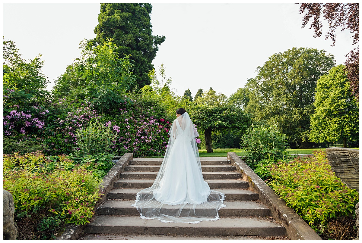 Bride on steps Coombe Abbey