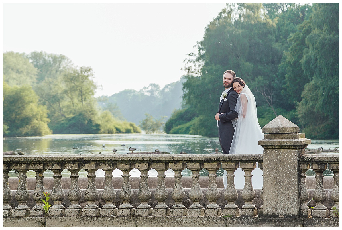 Bride and Groom on bridge Coombe Abbey